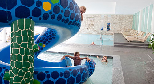 Swimmingpool for children with slide